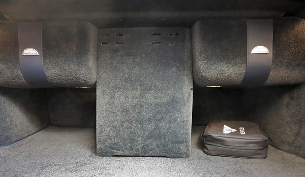 Part of the Naim installation in the boot: between the subwoofers is the Bentley's drinks fridge(!), while the little case houses the mains adapter for the car