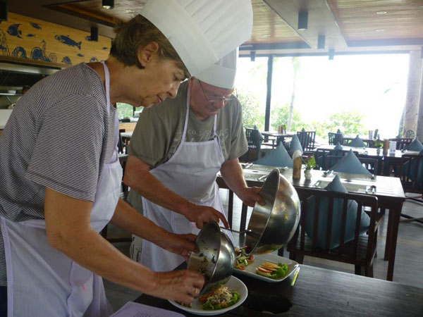 Caroline and Tony learning Thai cookery on their travels